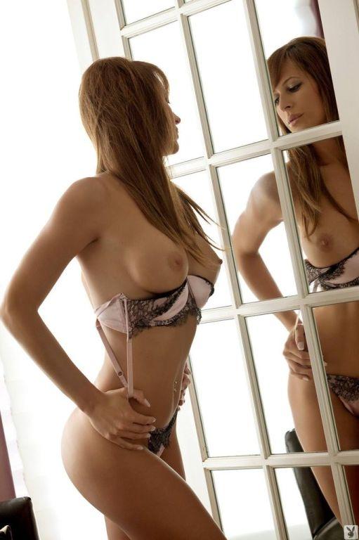 Brunette Nadia Larysa posing in her sexy lingerie