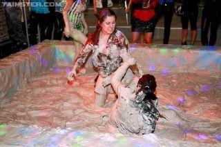 Lesbians wrestling in mud