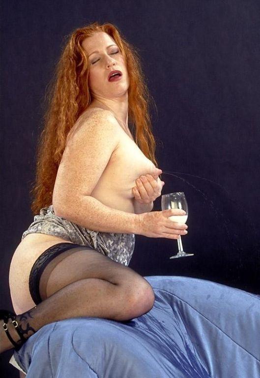 Lactating redhead babe milking tits