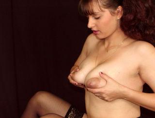 Lactating babe milking tits