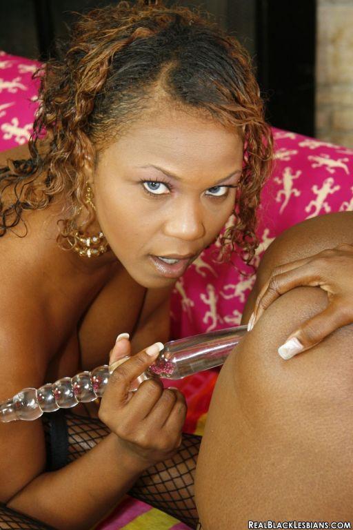 Mocha girl fucks her lover with a dildo
