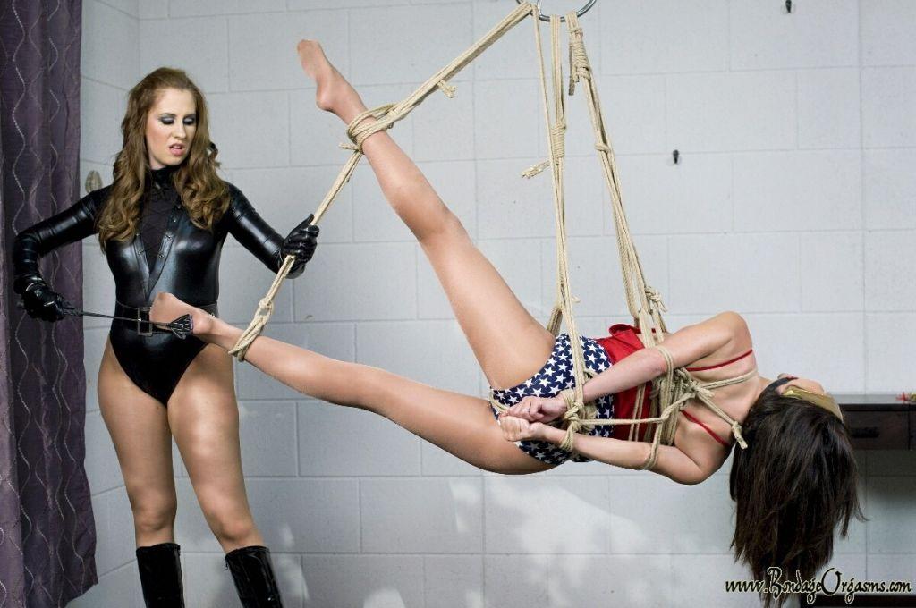 Natali Demore dominates super hero Ashley