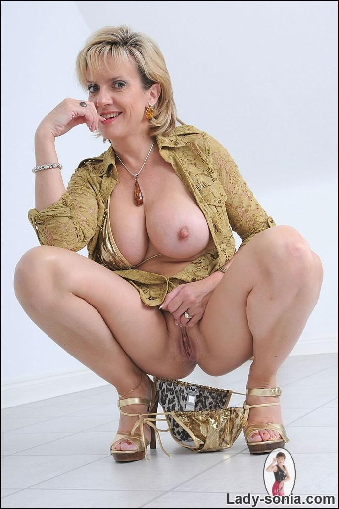 Gold black white bikini heels tits