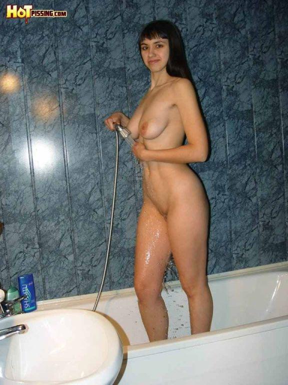 Slut pissing in the shower