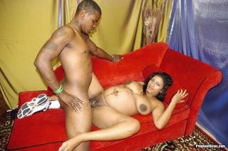 Horny black preggo loves big cock in her pussy