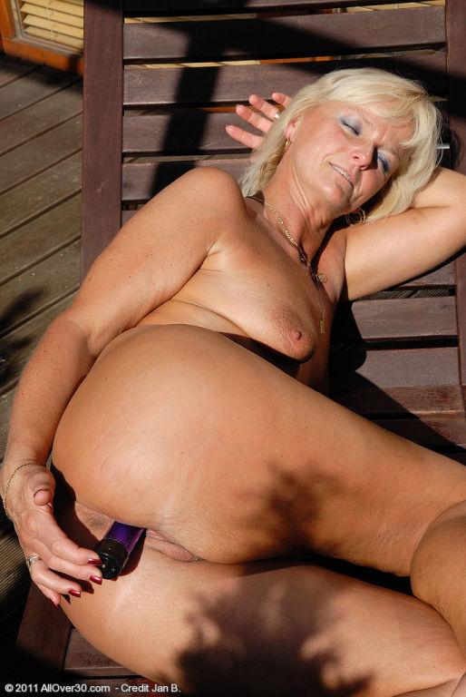 43 year old blonde Jenny slips her long purple dil