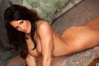 Seductive brunette shows toned nude body