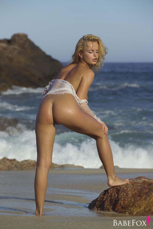 Hot blonde pornstar teasing at the beach