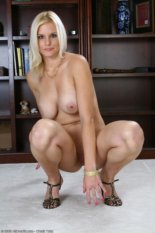 Elegant blonde MILF Slovanna slips off her dress