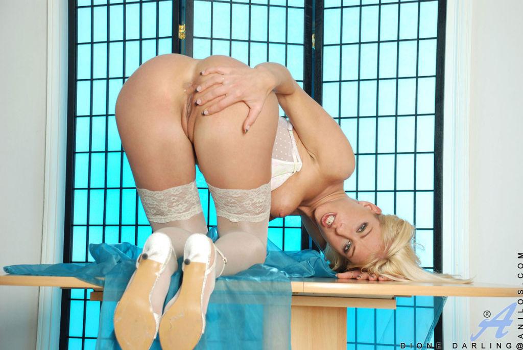 Leggy milf Dione Darling caresses her lingerie cla