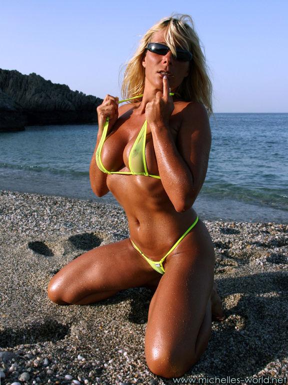 Busty blonde with transparent micro bikini