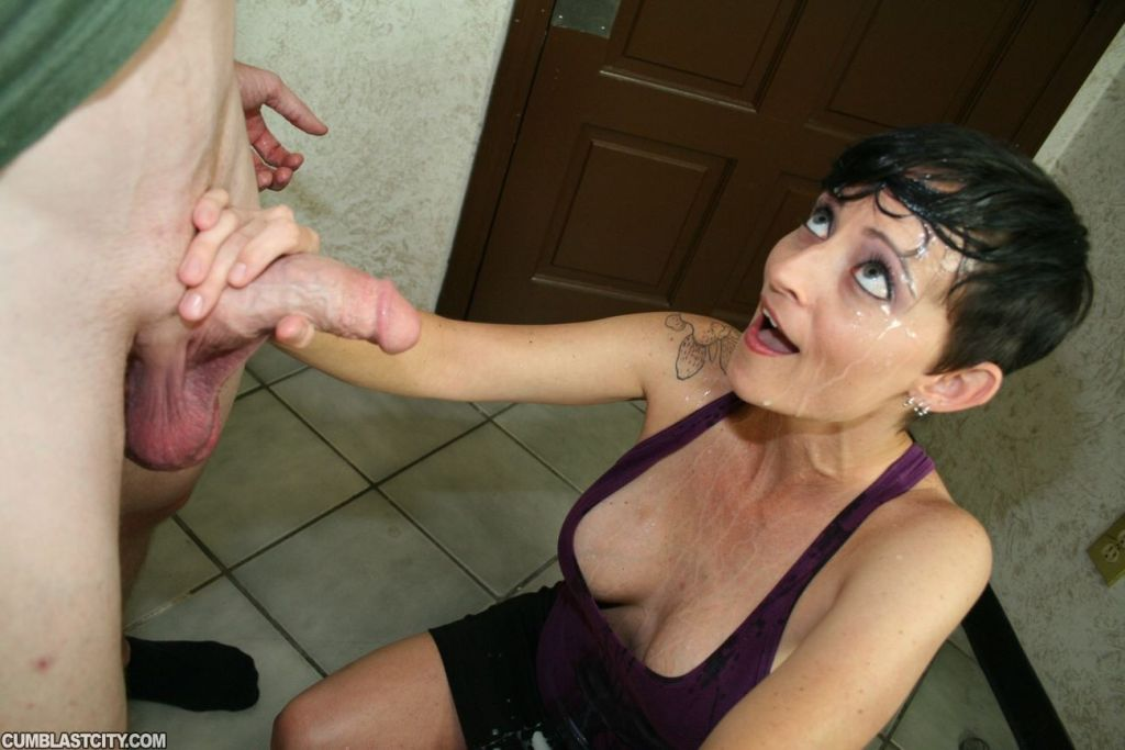 Milf gives hand job and gets face jizzed