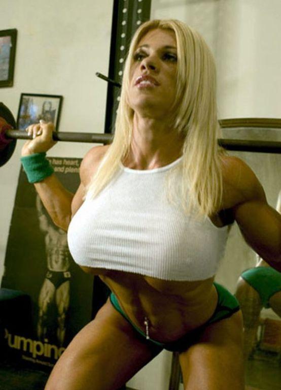 Cute female bodybuilder teasing in sexy dress