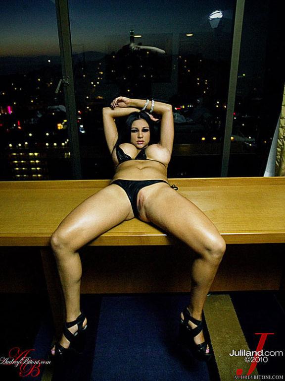 Audrey Bitoni masturbates by a window in the city