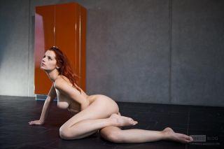 Amazing redhead Ariel posing her perfect body