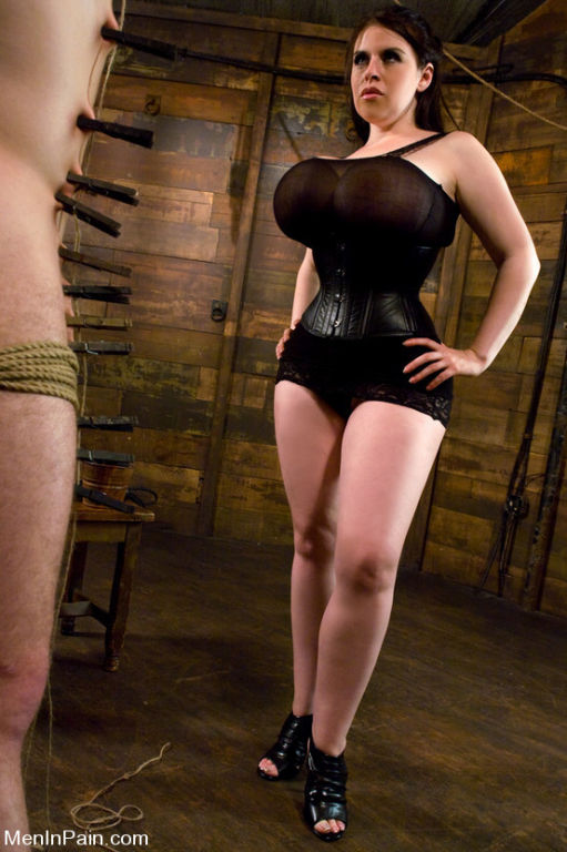 Gorgeous huge tits on Dominatrix beats slave boy a