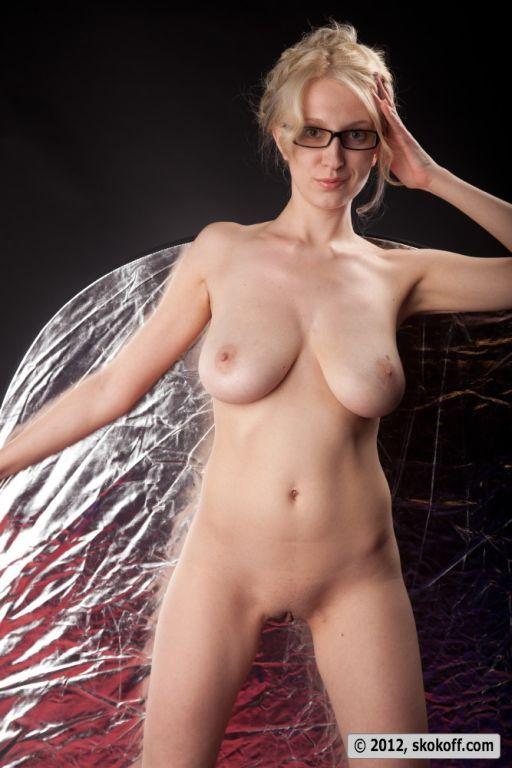 Blonde teacher posing naked wearing just her glass