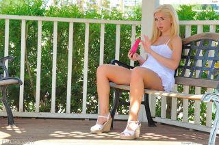 Daring amateur blonde masturbates in public gazebo