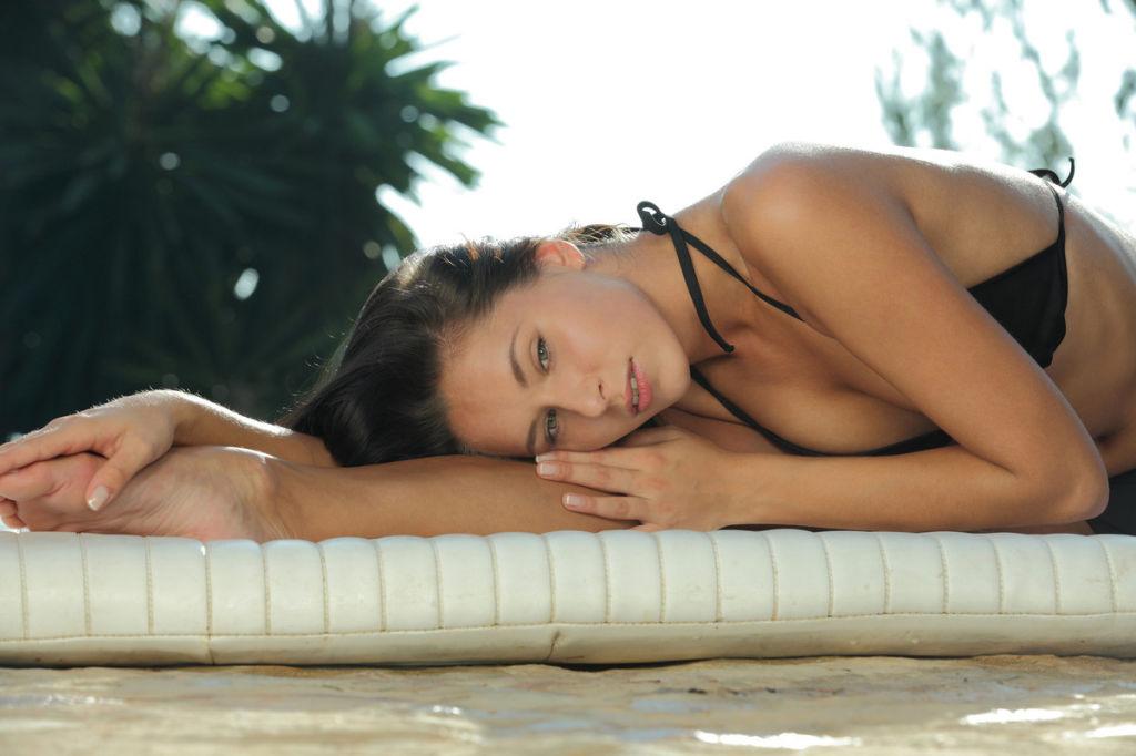 Bikini girl stretching