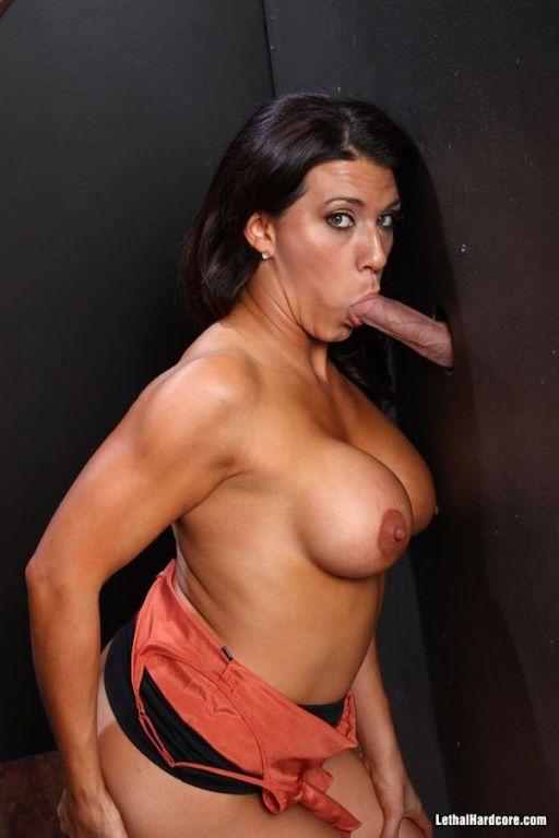 Busty Leena Sky wraps her lips around a gloryhole