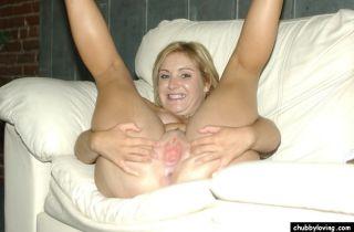 Adorable blonde plumper showing big pierced tits a