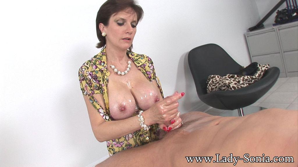 Oiled big tits milf Lady Sonia giving handjob