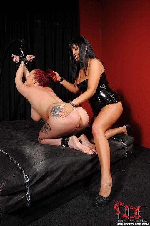 Jasmine Black mistress with female sub in bondage