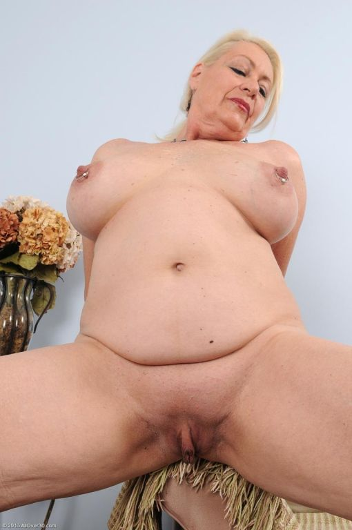 Horny busty mature shows pierced tits