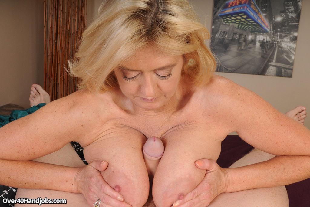 Blonde busty milf stroking big cock of her step so