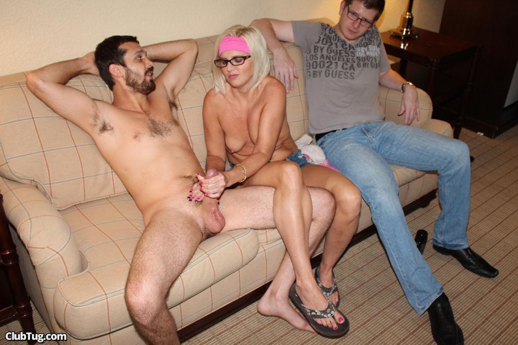 Milf jerking off stranger with her husband watchin