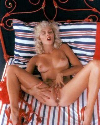 Vintage pornstar Ginger Lynn Allen masturbating in