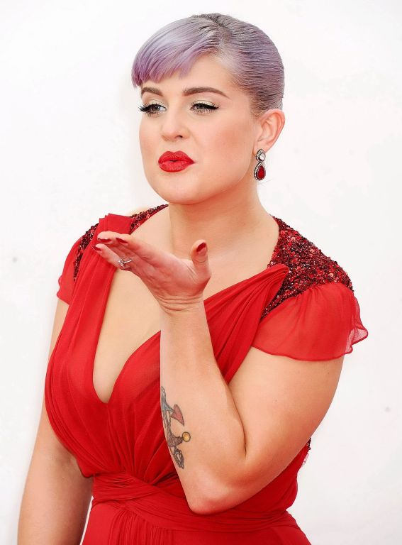 Chubby Kelly Osbourne showing huge cleavage at the