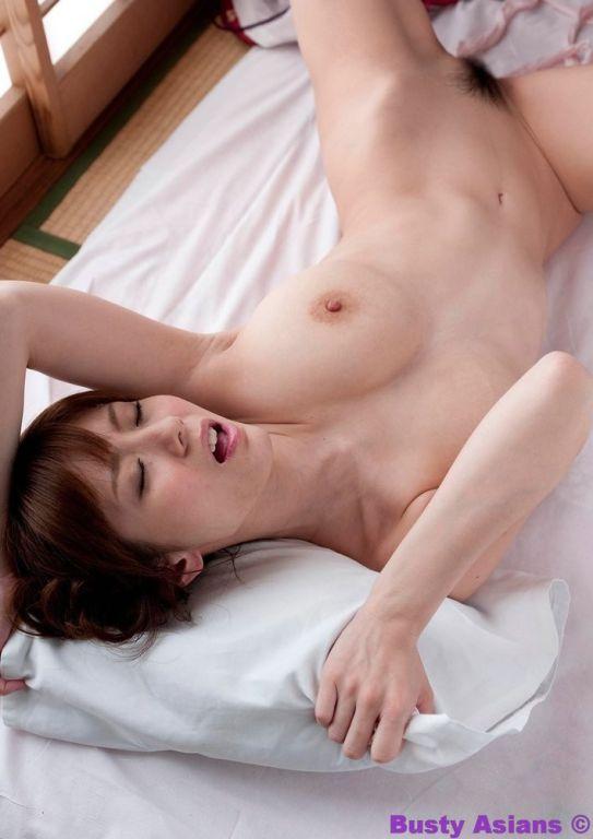 Busty japanese Yuma Asami posing in the dojo her b