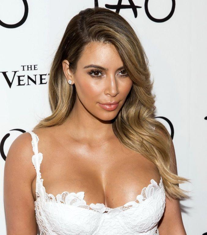 Busty Kim Kardashian showing huge cleavage at Tao