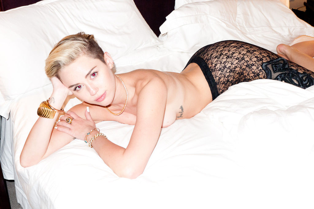 Celeb Miley Cyrus in sheer shirt and topless with