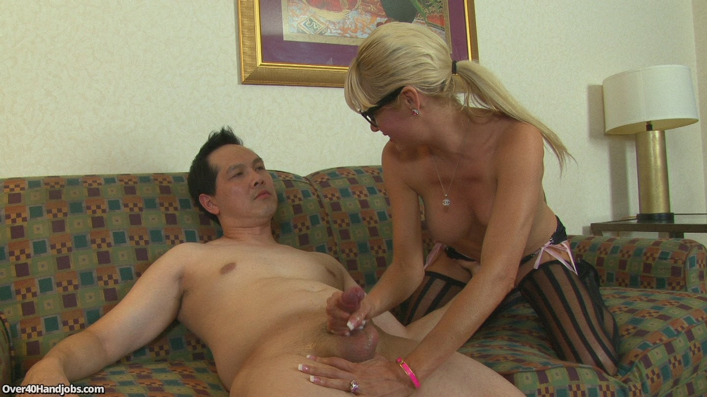 Mature woman gives handjob