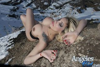 Gorgeous shemale frolics half naked in the cold sn