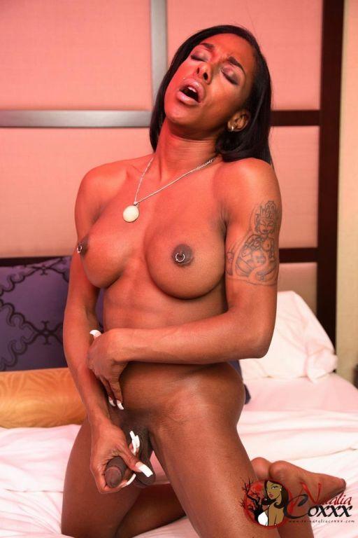 Ebony tranny Natalia Coxxx plays with her cock bef