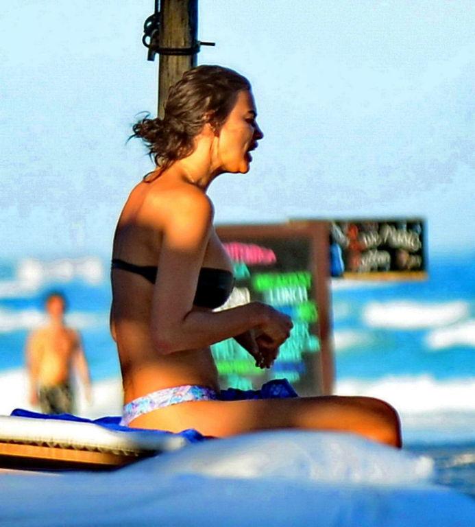 Irina Shayk showing off her bikini body on a beach