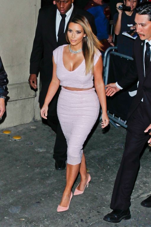 Kim Kardashian shows cleavage and booty while arri