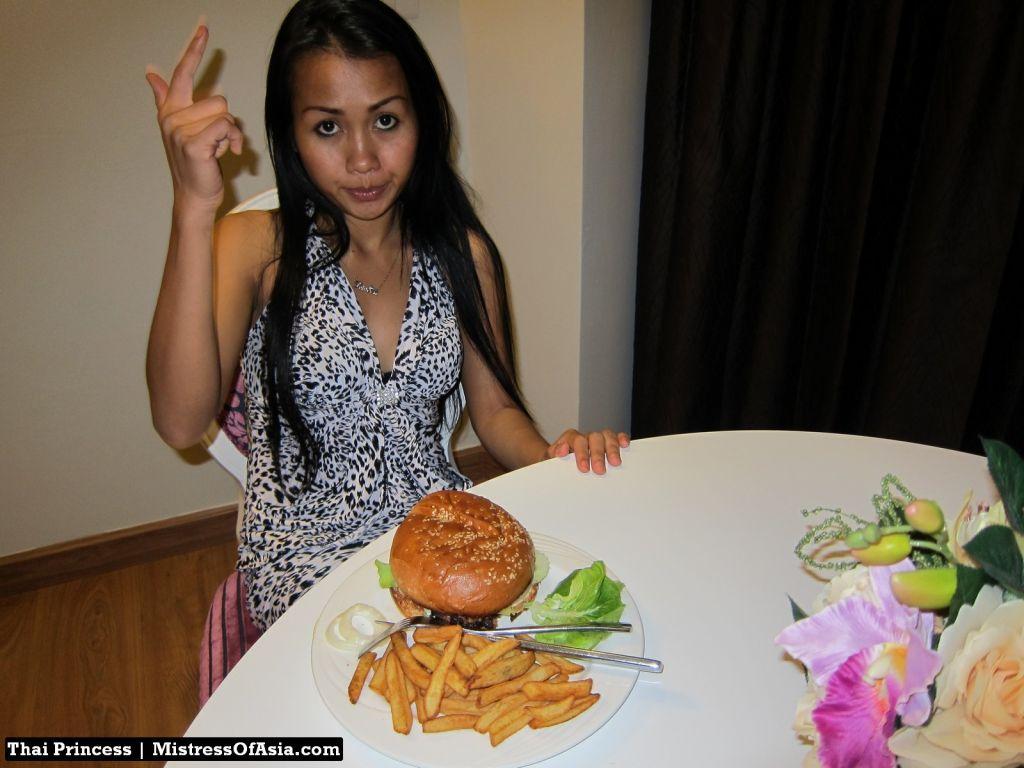Thai Princess eating burger