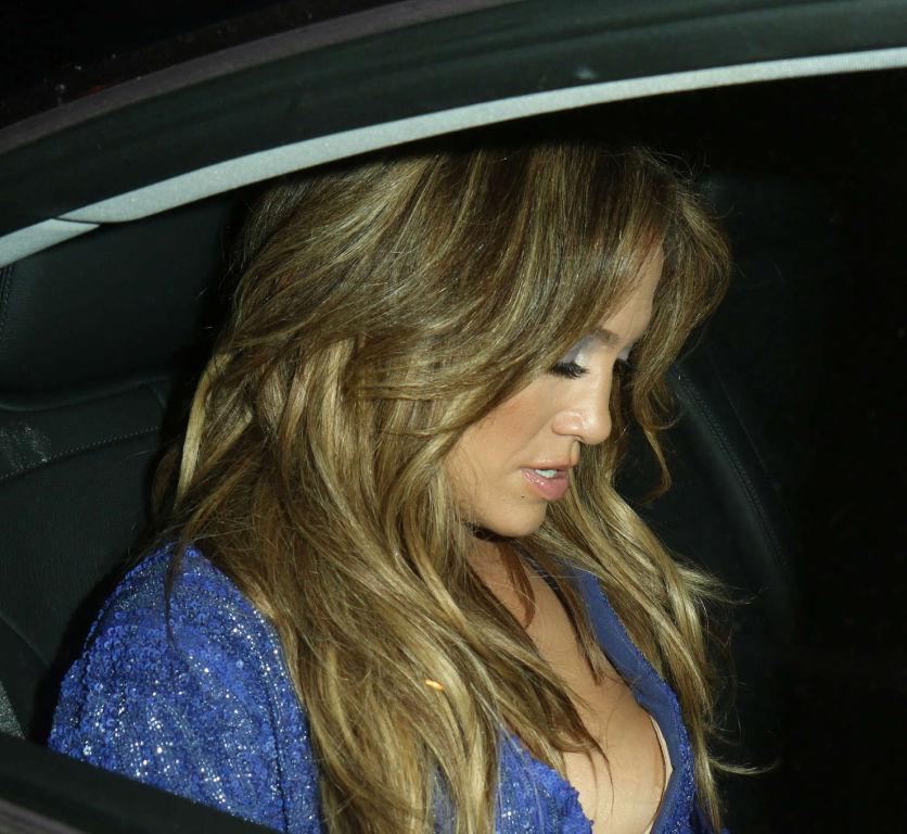 Jennifer Lopez cleavy and leggy wearing purple min