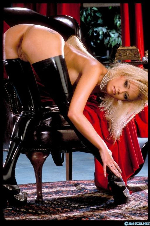 Jenna Jameson bends over in her thigh high fuck me