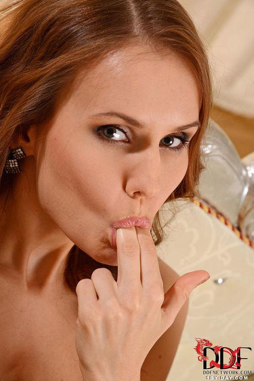 Sabrina Moore redhead strips black lingerie to spr