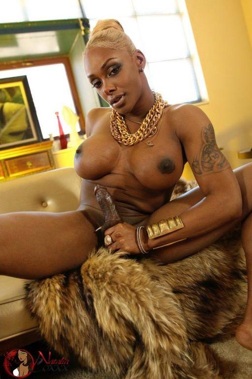 Shemale Natalia Coxxx in a leopard skin dress