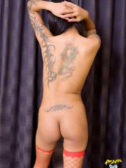 Thai cutie shows off her peirced nipples & pus