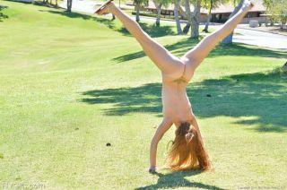 Sweet Irish teen naked cartwheels in a public park