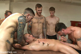 Horny crowd mercilessly gang fucks a bound stud ag