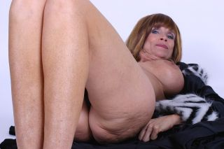 Grandma Marylin shows big tits and spreads her wet