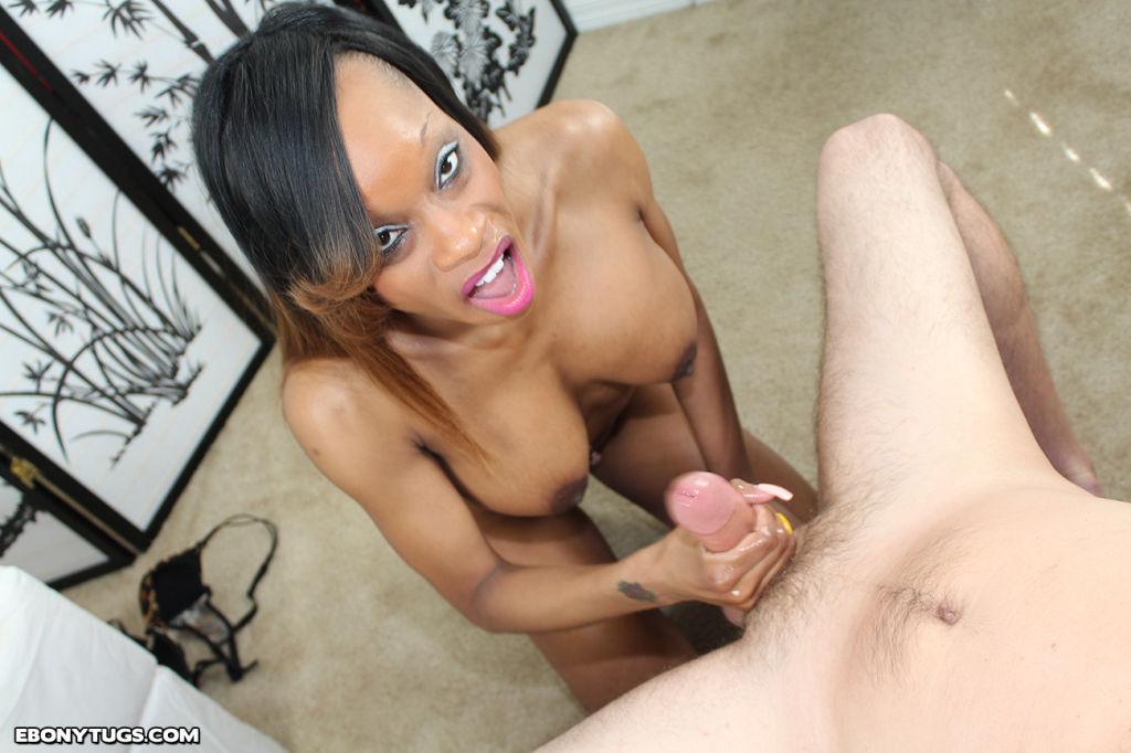 Busty ebony slut licking and stroking white cock